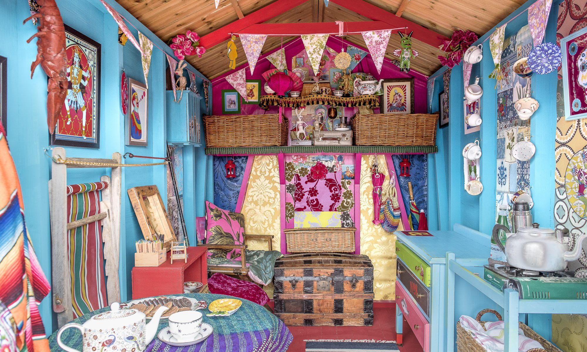 The beach hut is decorated in the same pink and blue colour scheme as Annemarie's house, with more wallpaper samples