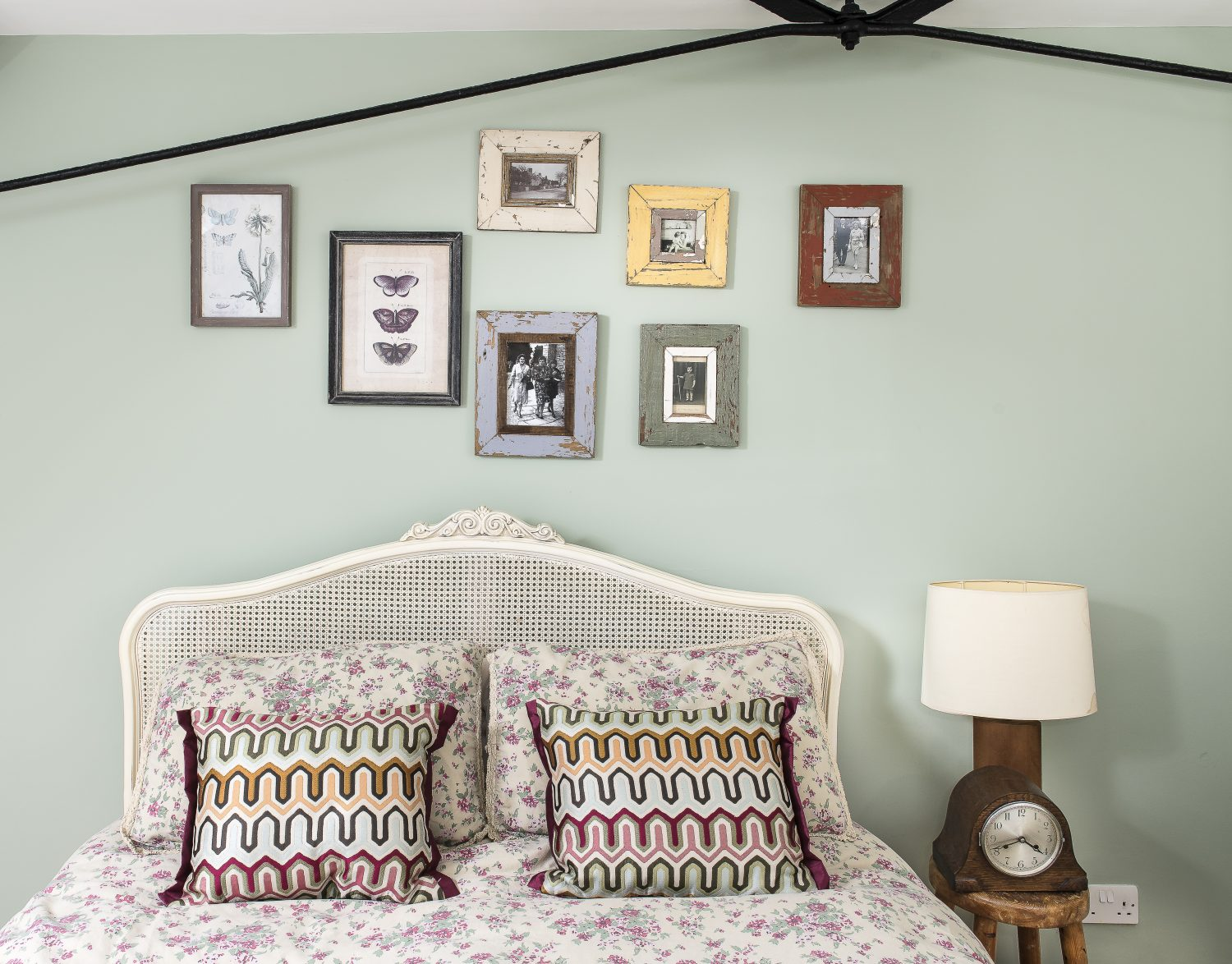 In the guest bedroom Rachel has revamped old family photos in old frames