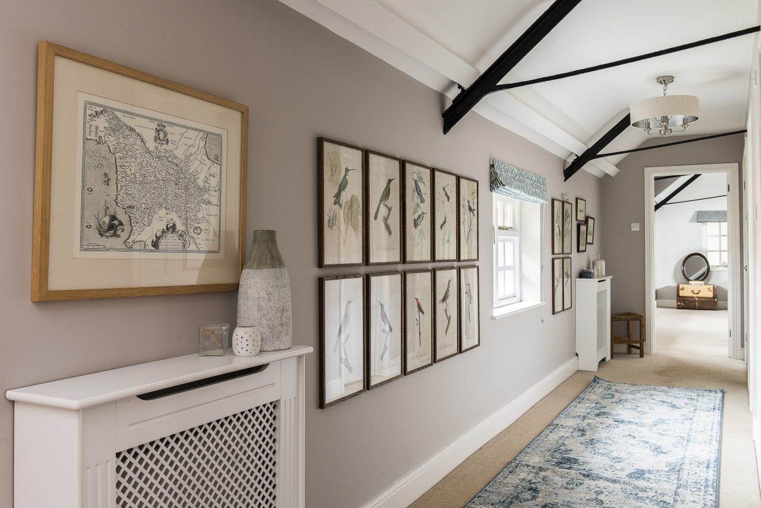 The upstairs hallway is lined with prints, some of which were bought on holiday in Italy