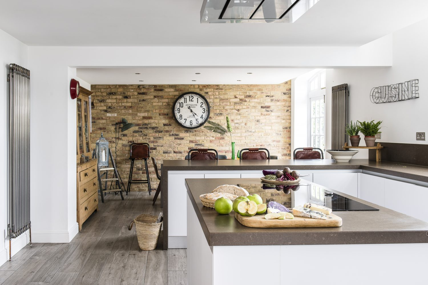 The old bricks at the back of the kitchen are special thin-cut bricks applied like tile