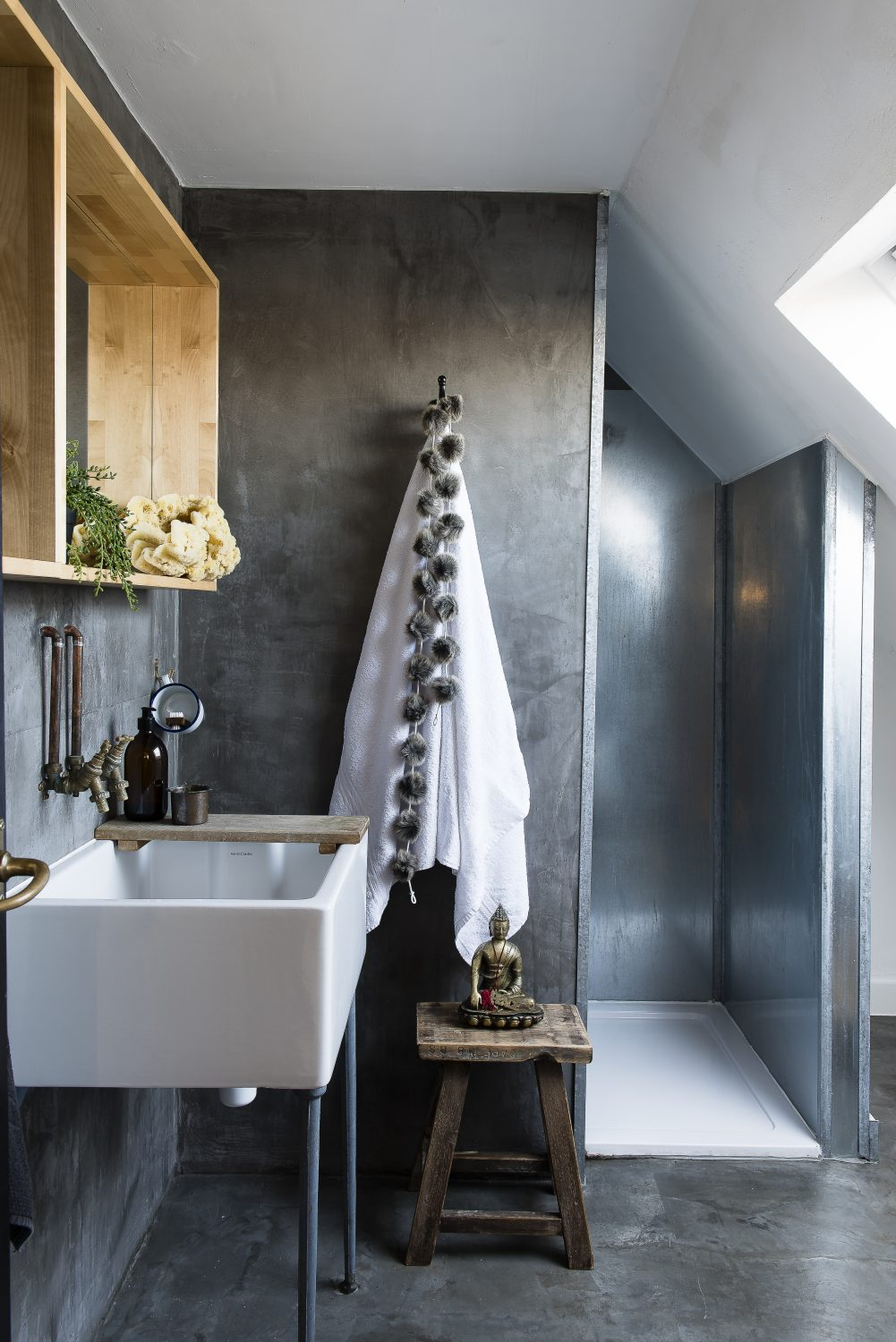 The shower enclosure in the downstairs bathroom is made from galvanised steel. The walls and floor are concrete screed