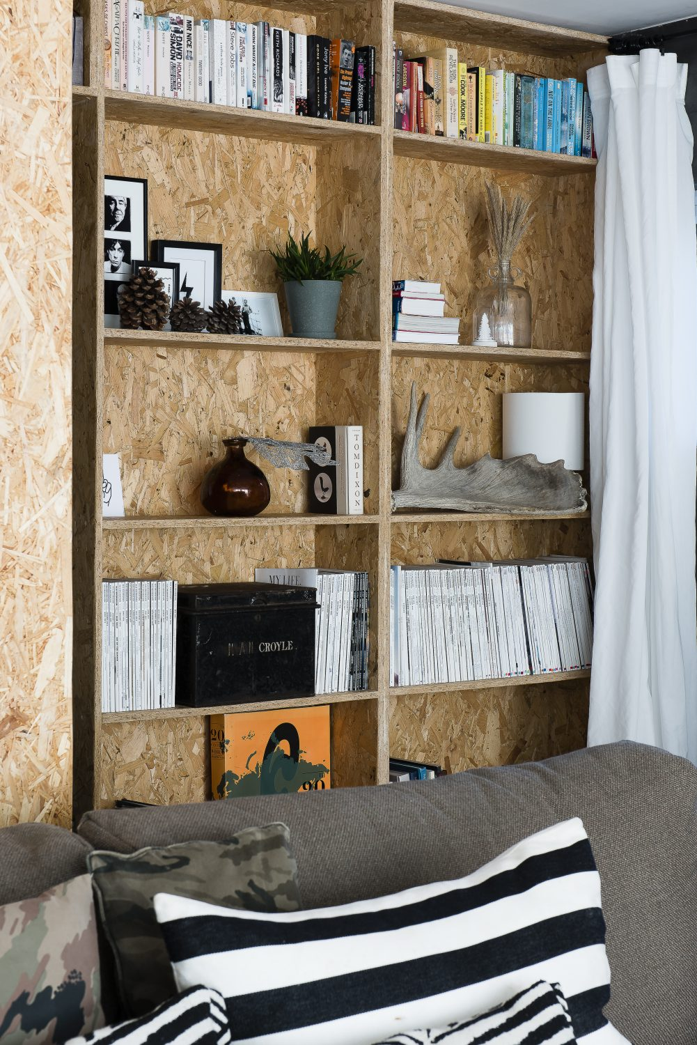 The back wall and shelves have been clad with OSB (flakeboard), which has been used throughout the house