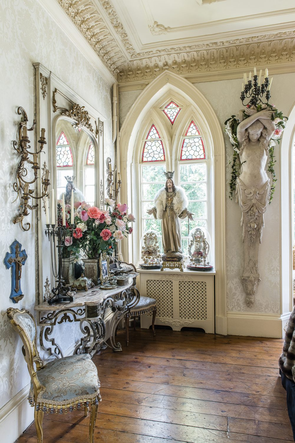 The seating area off Kim's boudoir. The caryatids – one on either side of the door – were from Architectural Salvage Brighton