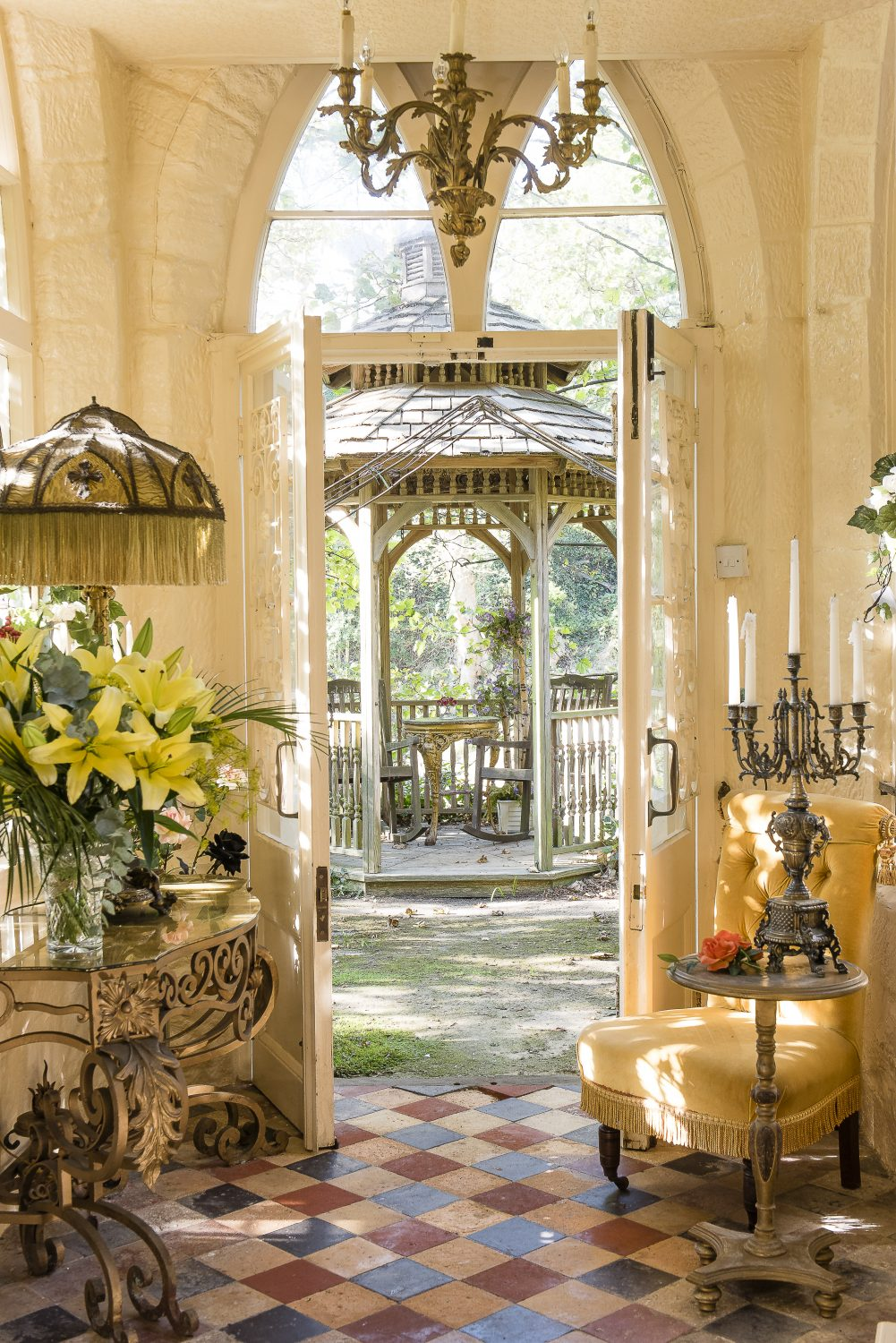 A tiled entrance porch leads out to the garden, with a bandstand-style summerhouse