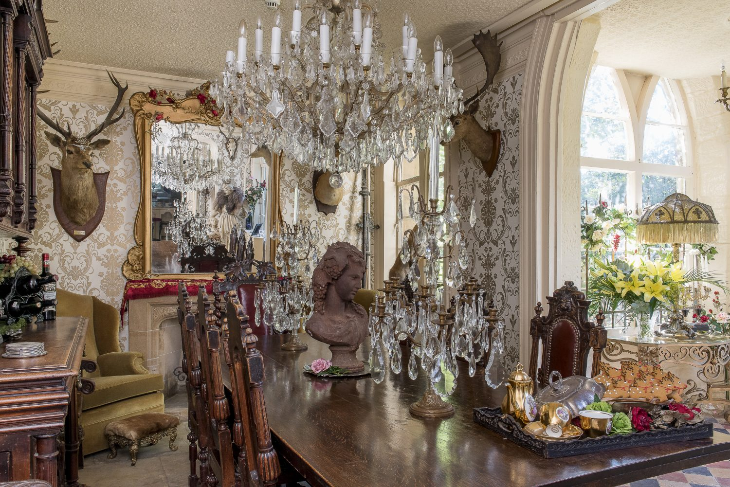 The enormous chandelier in the dining room is from Hastings Antiques Centre in Norman Road, St Leonards. The table was bought at an auction and the chairs from an antiques shop in Hastings Old Town. The gingerbread reindeer are from Judges Bakery, also in Hastings Old Town