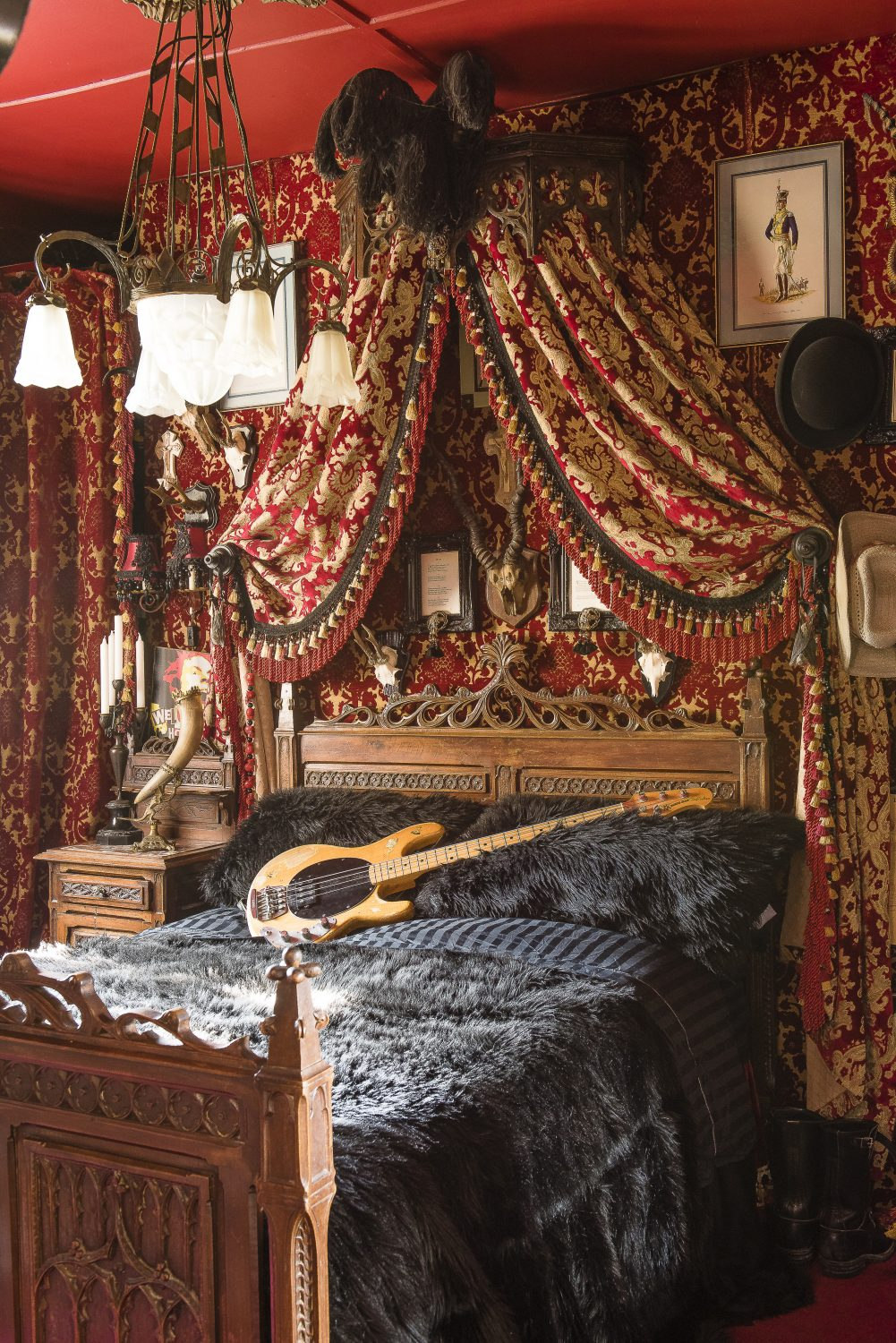 The lower ground-floor bedroom is Paul's bass-playing retreat. The bed and side table are attributed to Augustus Pugin, Paul covered the walls in fabric from Wayward using a staple gun