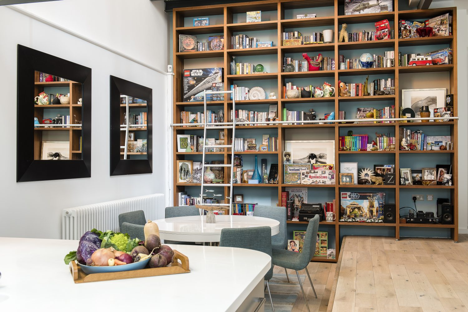 The two-storey oak shelves are by German firm Hulsta