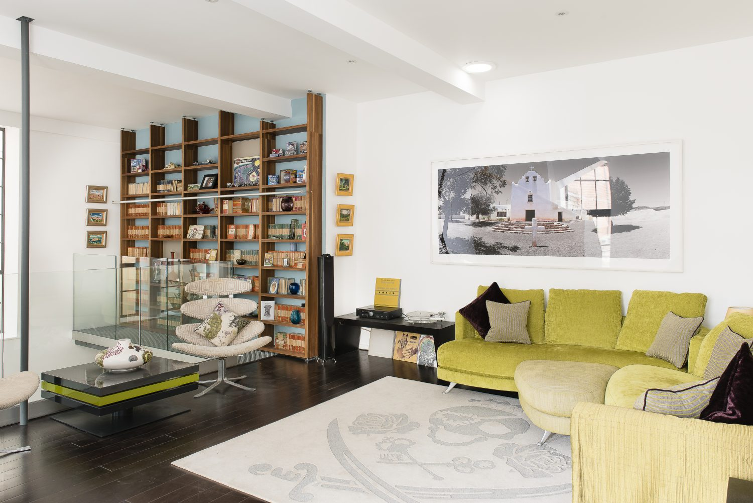 A sitting area on the first floor. The sofa is by Ligne Roset and the photograph of Pueblo Laguna in Mexico is by Boyd & Evans. The skull and crossbones rug is from Sunniva in Tunbridge Wells