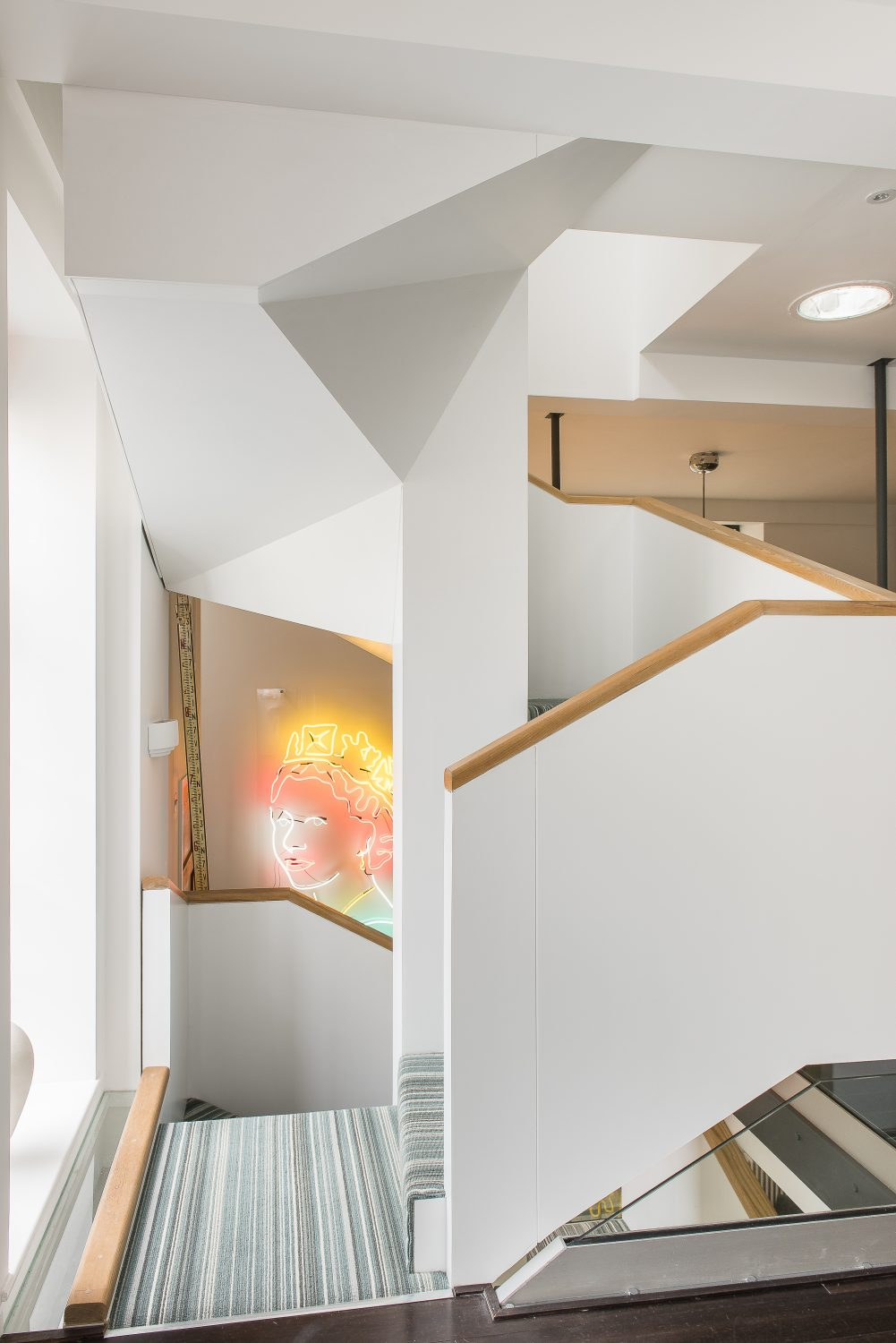 A specially designed helical staircase, built from MDF by a local company, dominates the centre of the house