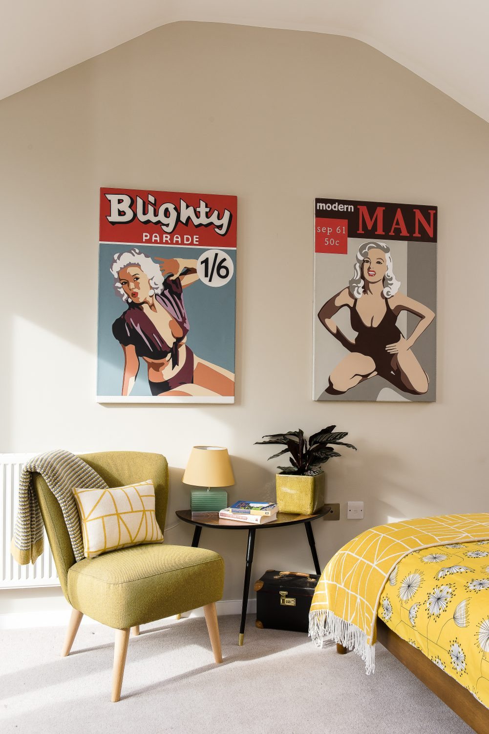 The 1950s magazine-inspired paintings in the master bedroom are by Julian St Clair