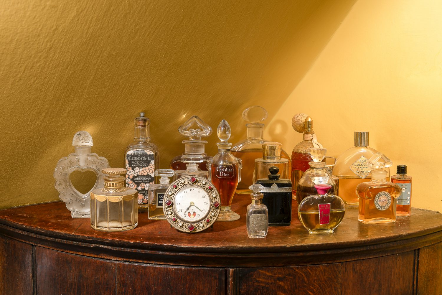 More of Will's vintage perfume bottle collection, displayed in the dressing room and the master bedroom