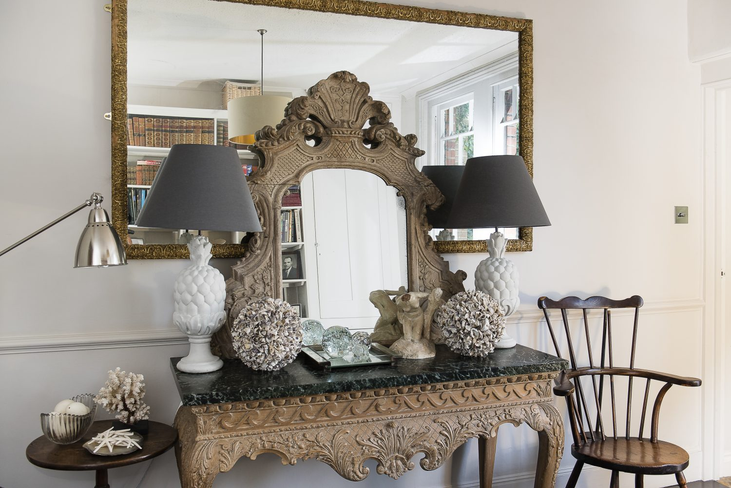 In Streett's study, decorated by Charlotte, the George III marble-topped table and rococo mirror are from Streett's collection. Charlotte added the 1970s French pineapple lamps. The chair is a Windsor Goldsmith, from circa 1890