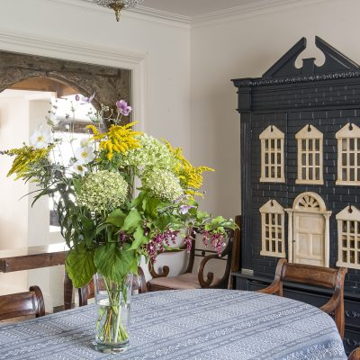 Julia bought the doll's house in an antique shop and painted it in Farrow & Ball Railings