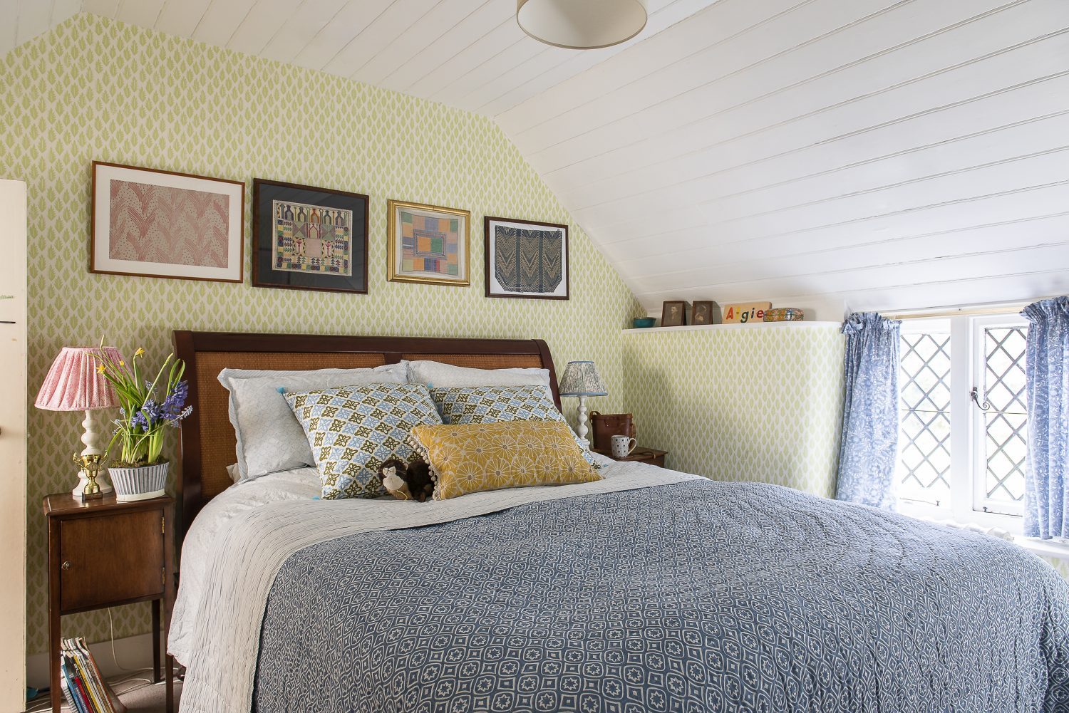 Over the bed in the guest bedroom on the far left and far right are two block-printed fabric samples by Barron and Larcher, early 20th century pioneers in fabric design who have been a big influence on Molly's work