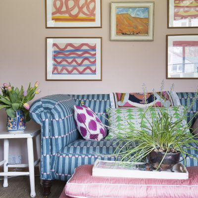 The sofa in the sitting room is covered in Molly's award-winning Luna fabric