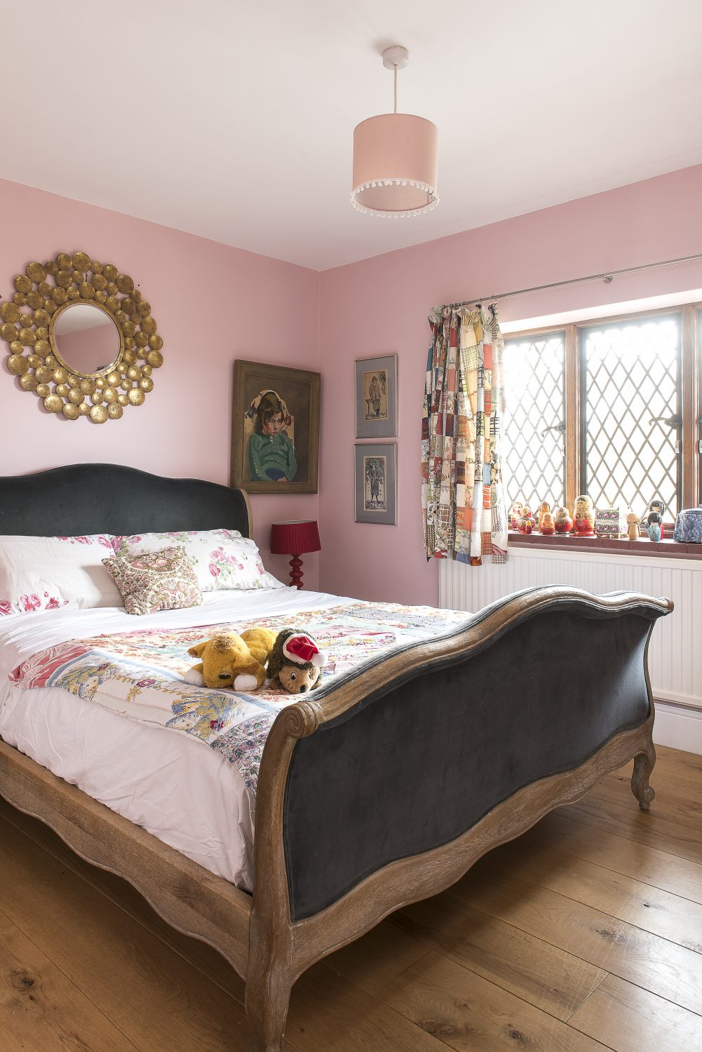 In the grandchildren's bedroom kitsch paintings are hung in groups on the walls and retro toys and objects style the furniture that Clare found in a Hastings junk shop