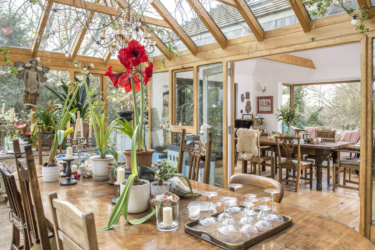 Previous pages & above: In order to create a better and more open space for socialising Clare knocked down the walls of the old entrance hall and sitting room, and connected the conservatory with the old kitchen