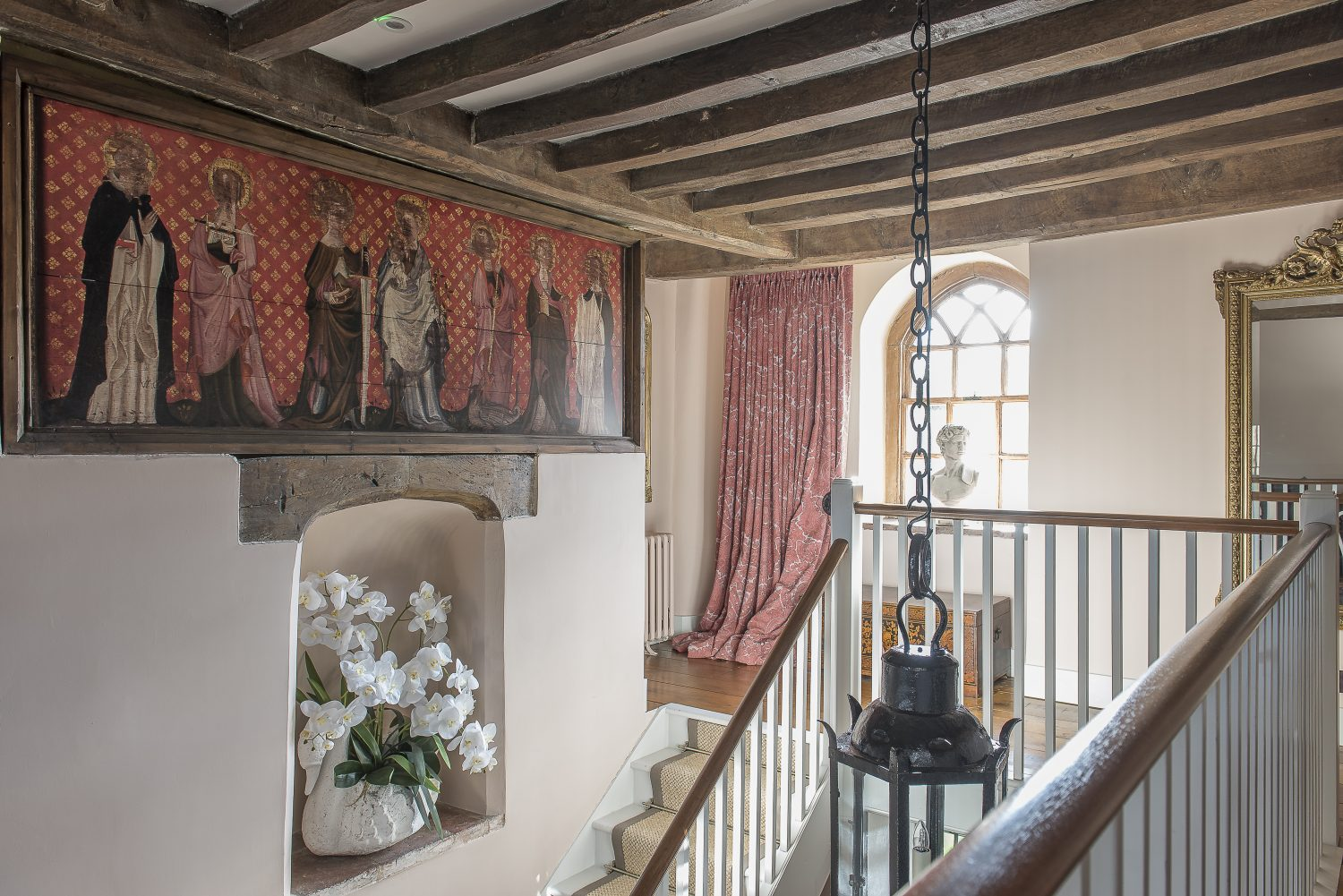 The mural is a replica of the very rare painted altarpiece found during a restoration of Battel Hall in the 1860s. The original is in Leeds Castle chapel