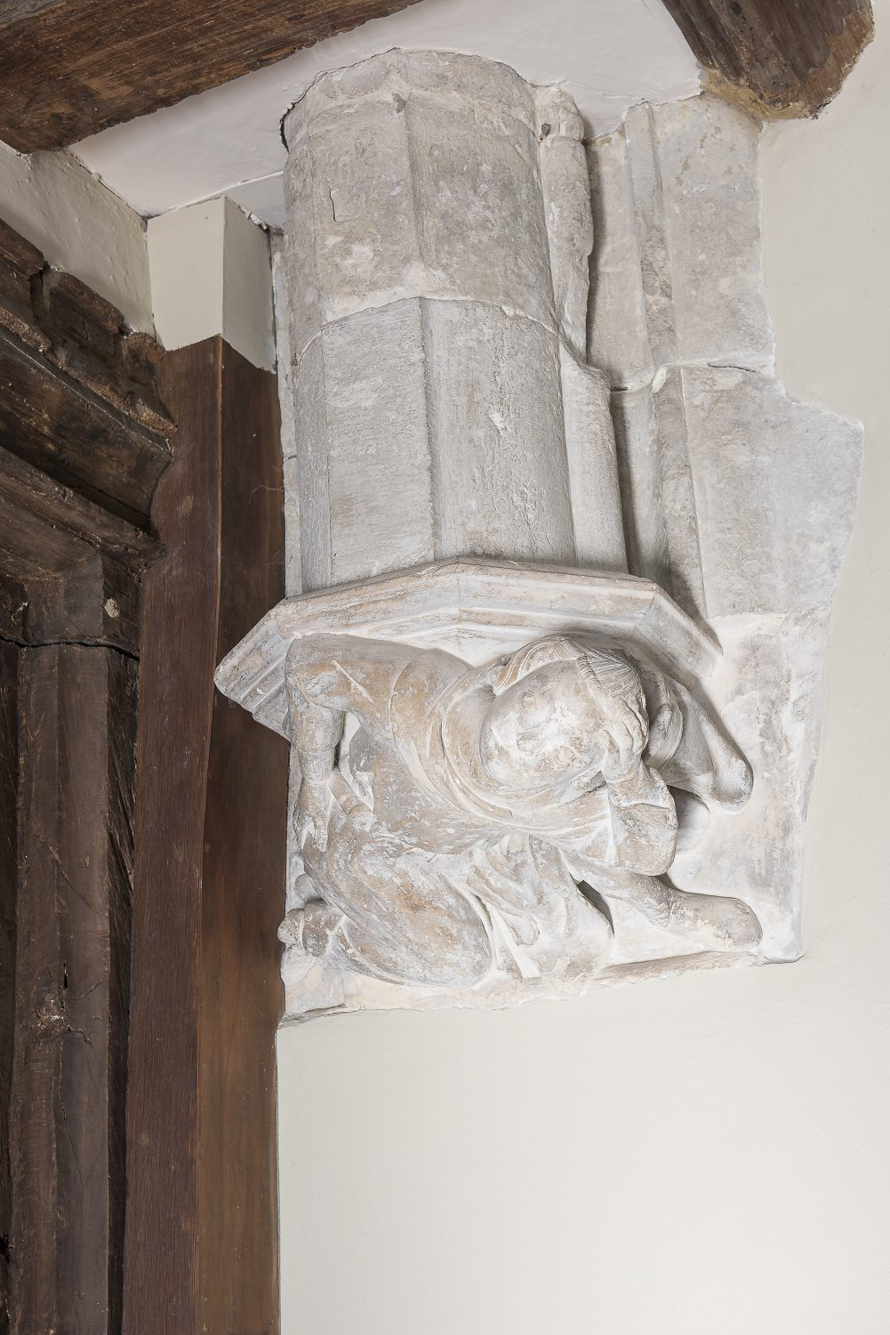 One of the building's original architectural details, an intricately carved corbel in the dining room