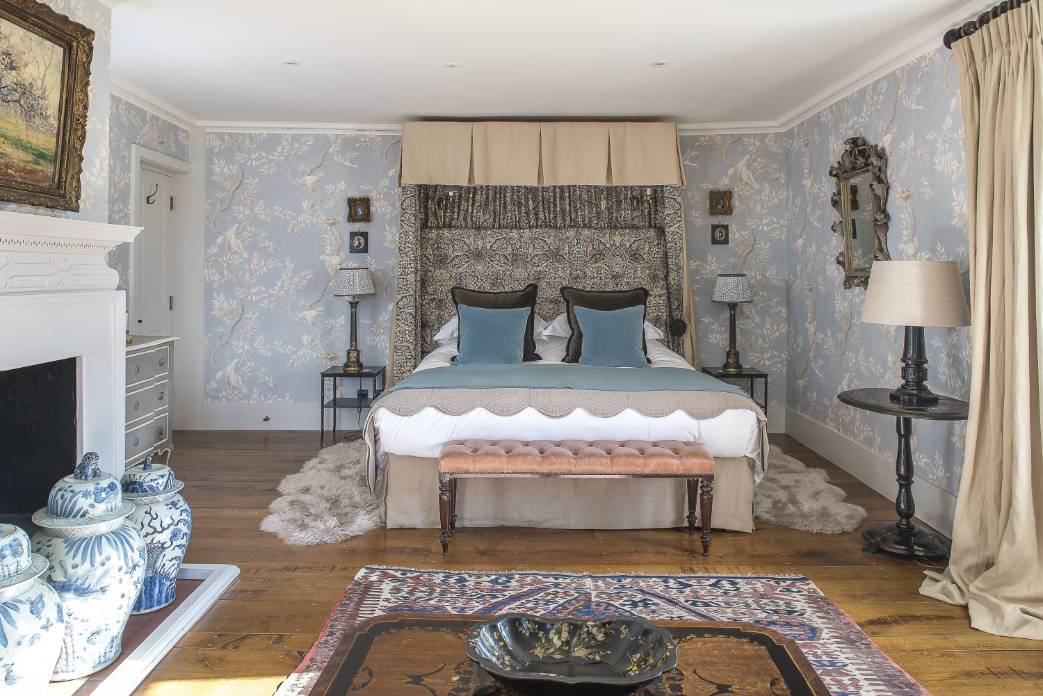The headboard is covered in Alhambra by Lewis & Wood