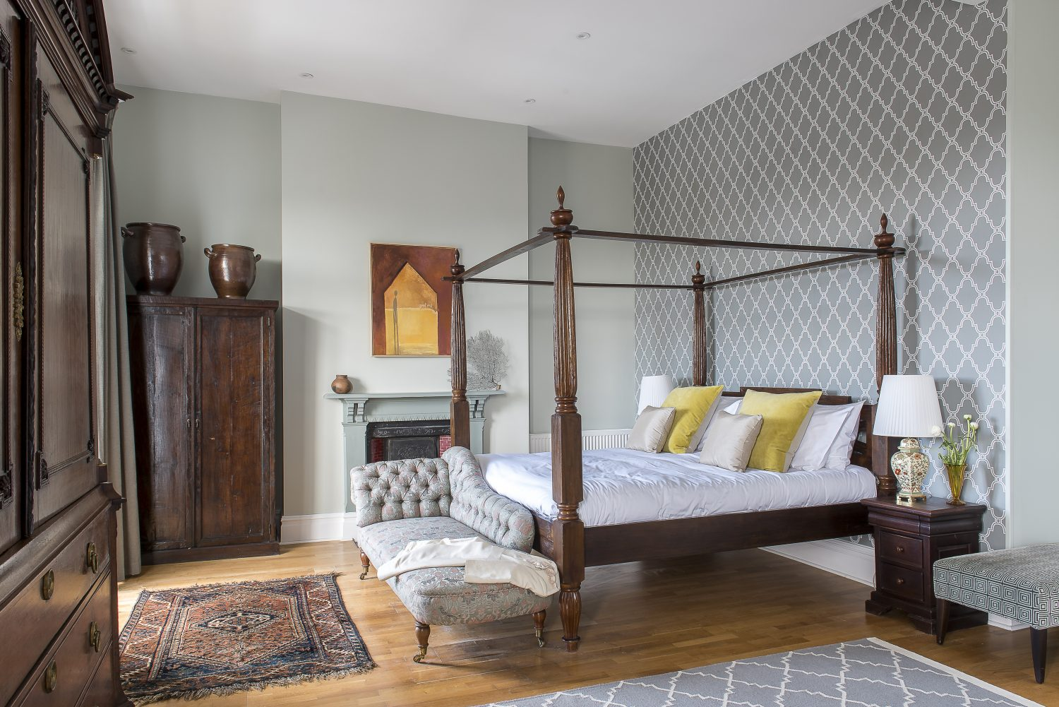 The huge master bedroom is home to a splendid 17th century armoire. The four-poster frame bed was tracked down on eBay