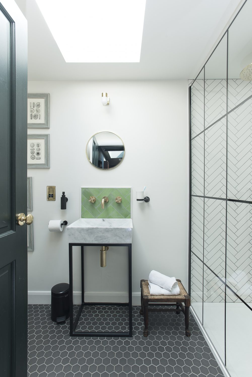 The bathroom is small but perfectly formed, with a shower screen that echoes the black metal Crittal-feel windows and doors throughout The Outbuilding