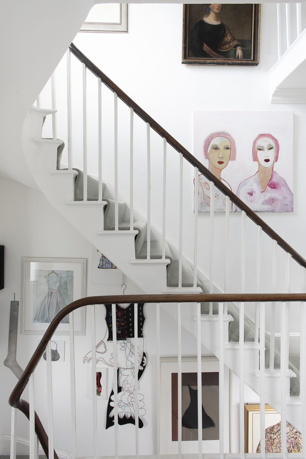 Artwork features prominently on the walls of the staircase