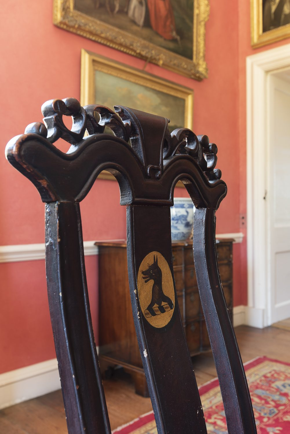 The formal dining room's chairs feature the wolf head that is in the family crest