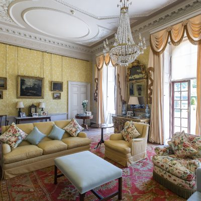 The drawing room was beautifully decorated by Henry's mother Anthea with decorative wallpaper she commissioned specially. French windows take you out into the formal back garden