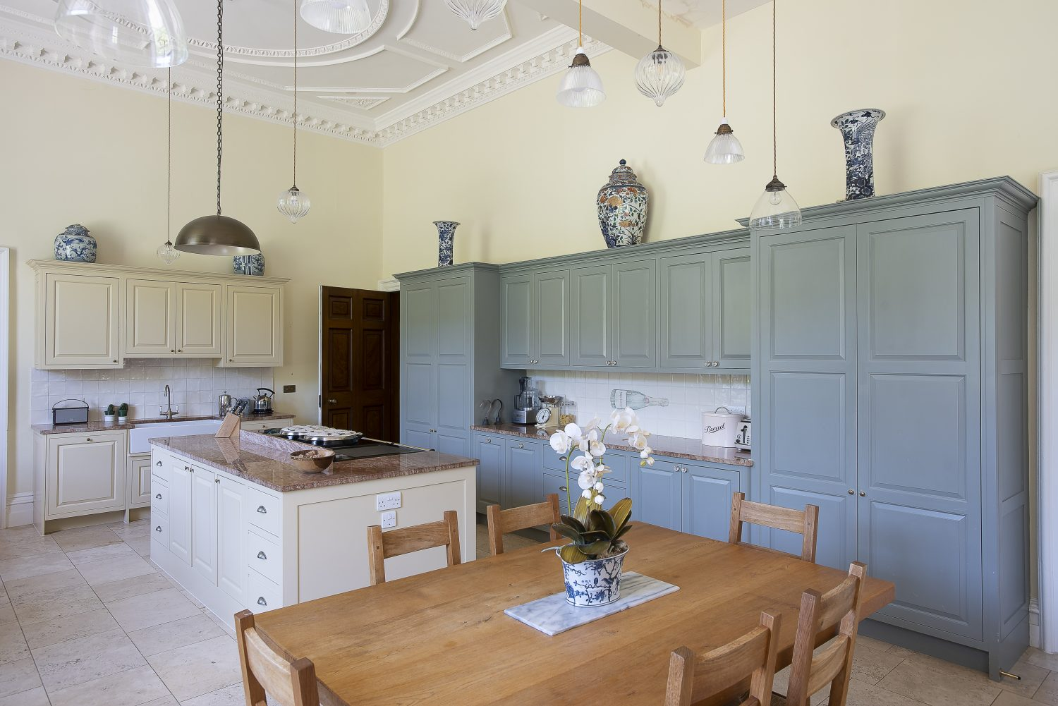 Henry and Claire knocked through a small kitchen and dining room to create a family kitchen. The lights above the dining table were found throughout the house by Clair