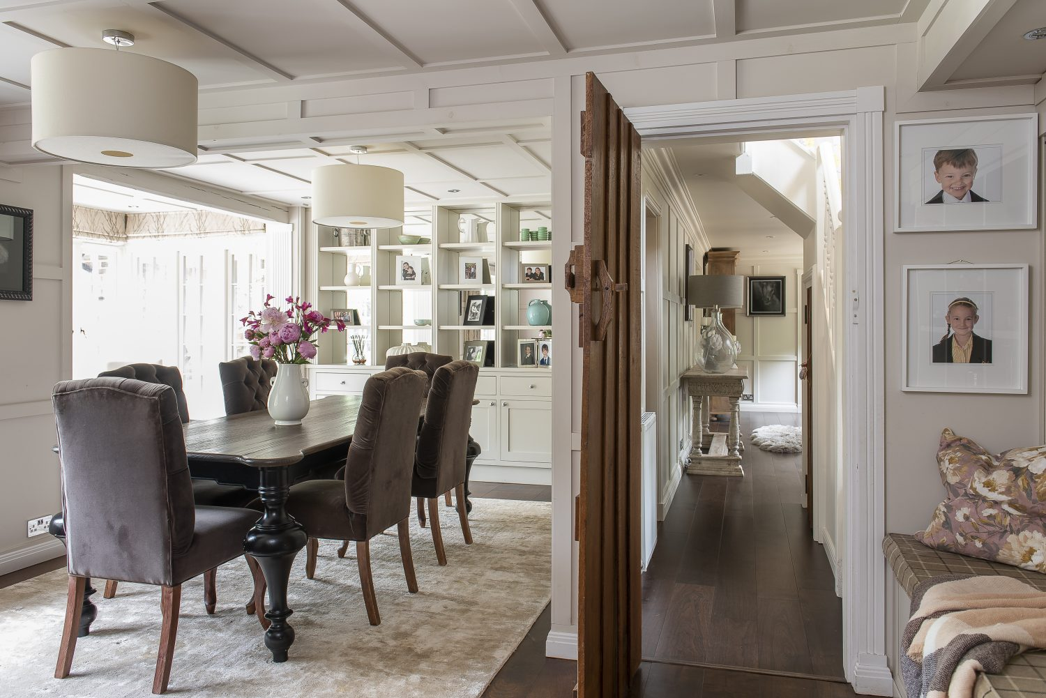 The old kitchen and dining rooms were combined to make one large room. Karen and Rafe made a feature of the panelling here on the ceilings as well as the walls