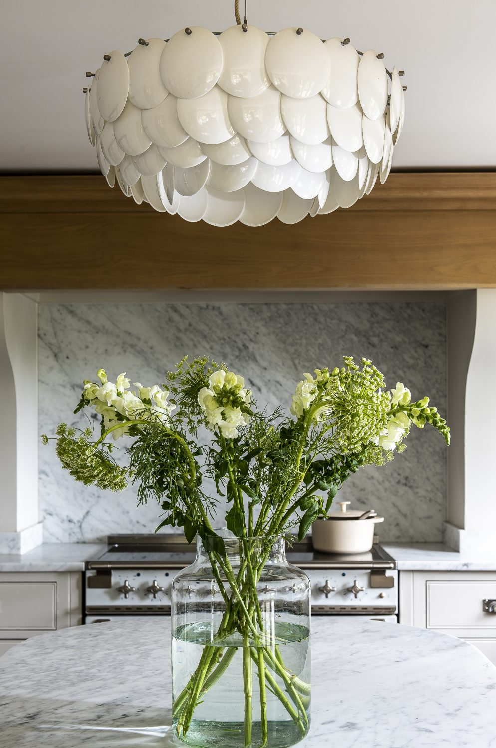 The stunning ceramic light from Heal's and the white glossy range add a touch of glamour