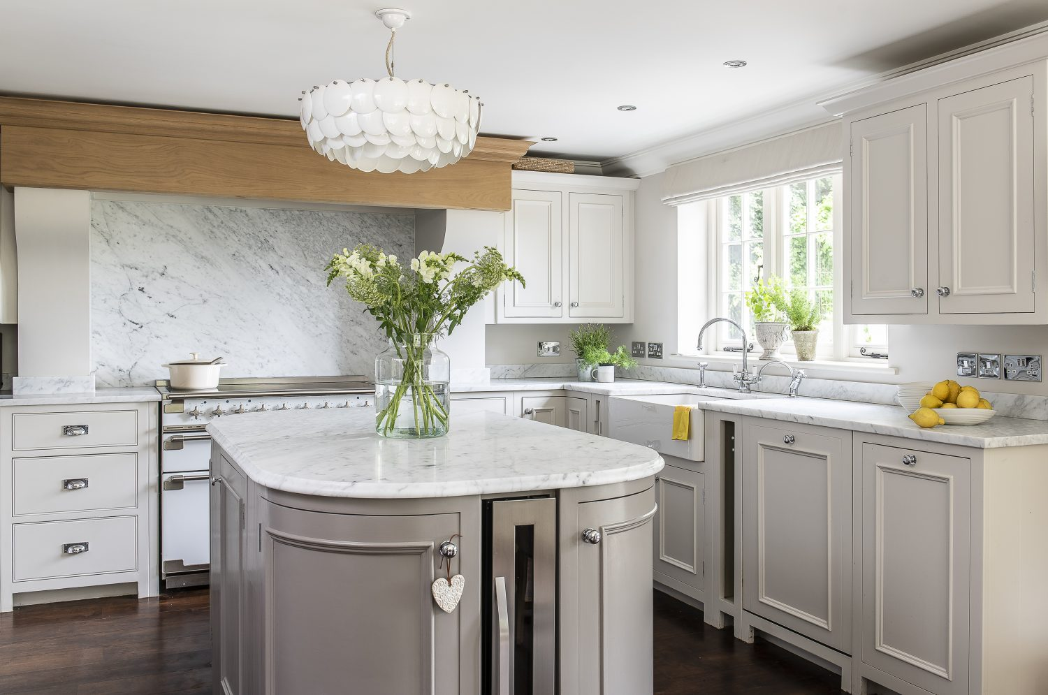 Karen knew she wanted her new kitchen to be light and spacious. The white marble worktop and pale grey units are sleek and sophisticated, while the table and chairs add a homely touch for family dining
