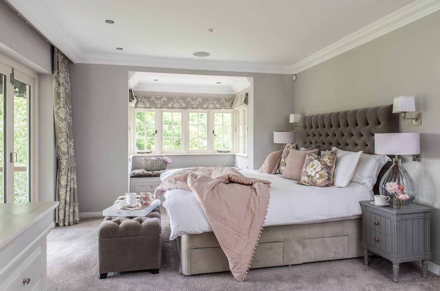 Simple opulence best describes this bedroom. The bed looks straight onto the charming oak balcony and the garden with the buttercup field beyond