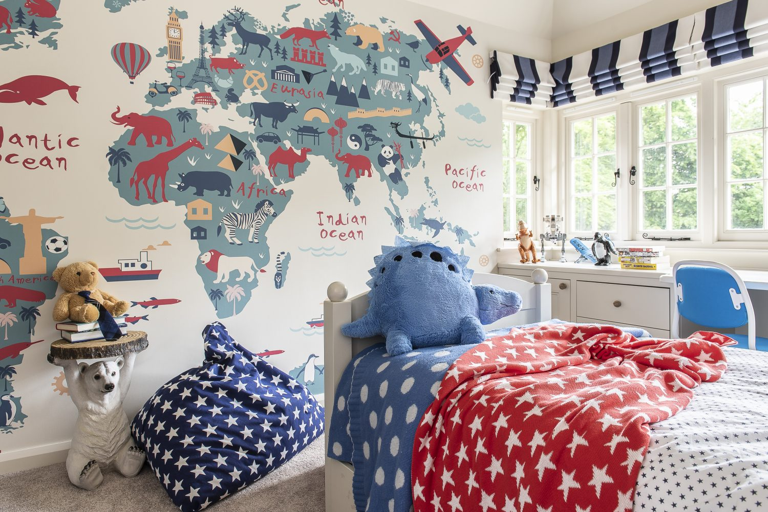 Freddie's room benefits from one of the rectangular bay windows, which bring so much light into the room The funky world map wallpaper is from Murals Wallpaper