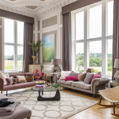 In the sitting room, Jaime has kept the colour palette to neutral greys and browns with white detailing. The double aspect windows take centre stage, with beautiful views out over the Bayham gardens