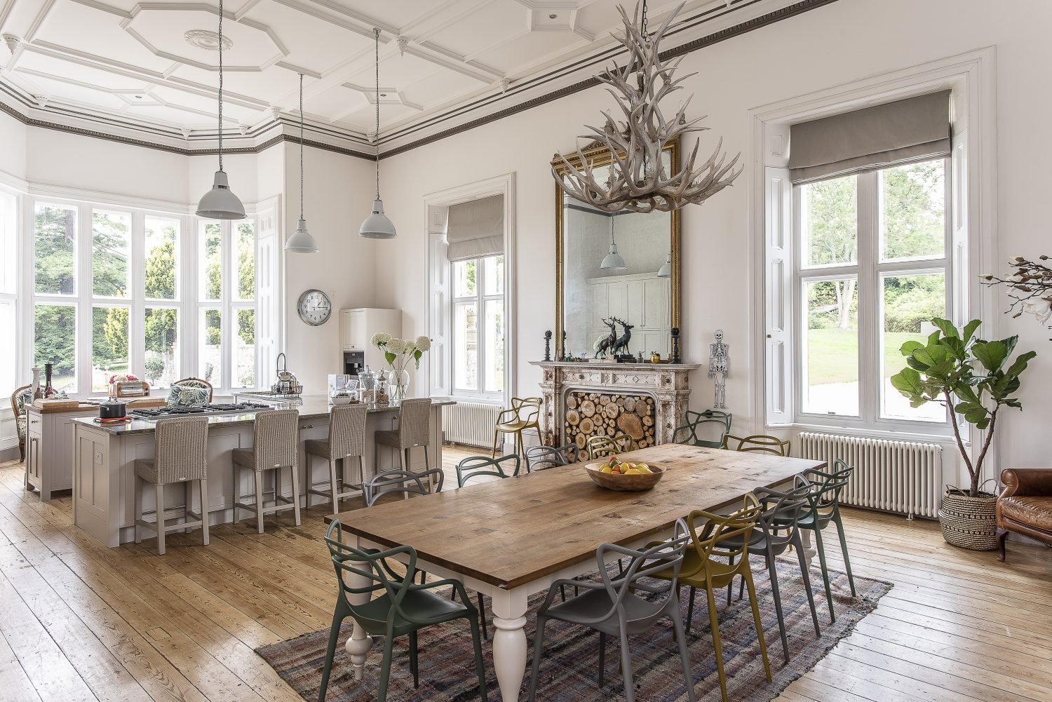 The kitchen had once been the library. Jaime stripped back the tooled leather wallpaper and pulled down 1970s partitions and stud walls to bring back the sense of scale from the original floor plan. The room's original features include a wonderful ornate plaster ceiling, huge windows and original shutters and an impressive veined marble fireplace