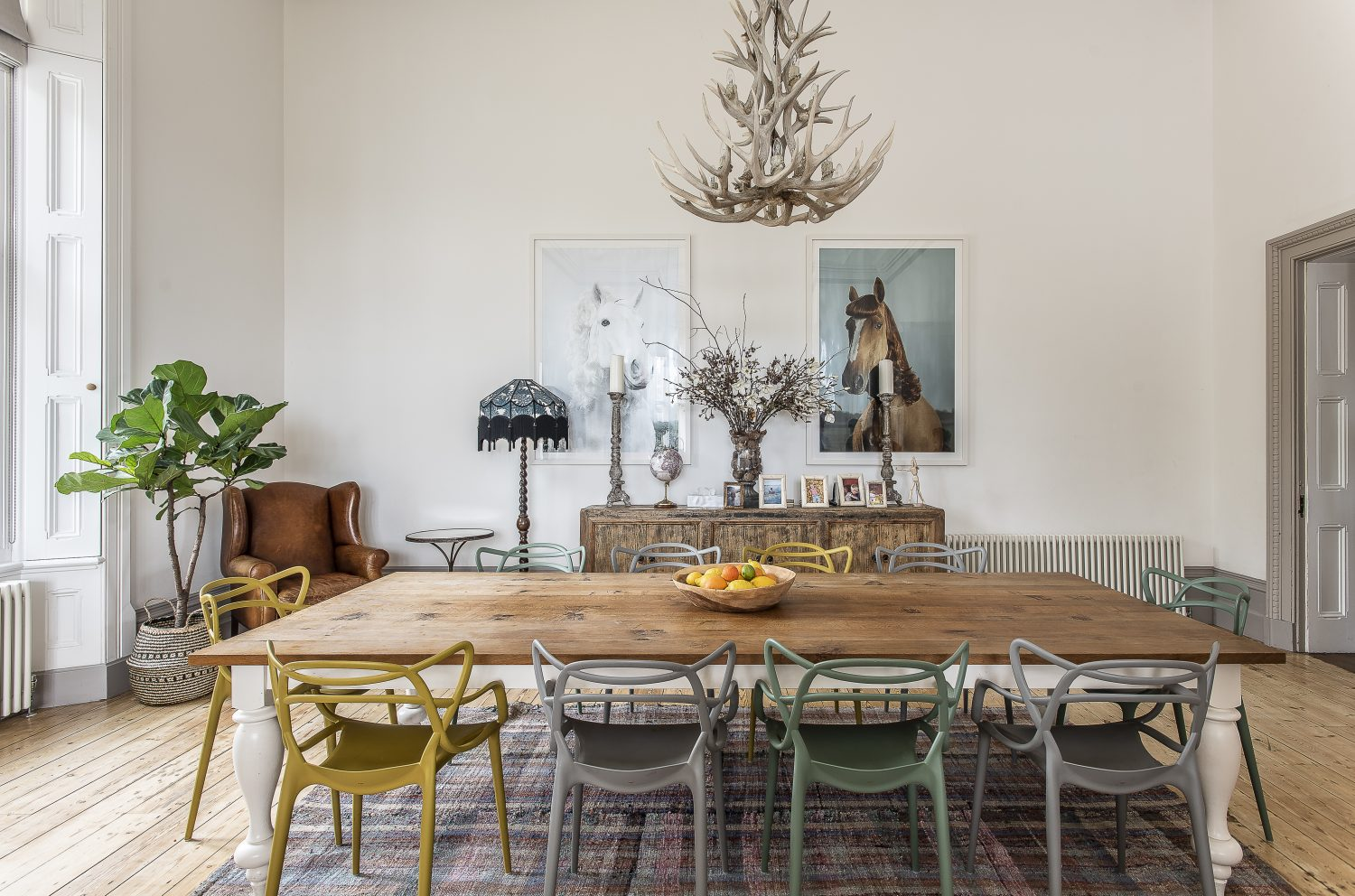 When Jaime and Justin moved their family down from London they also brought much of their art collection with them: 'Pony Pin Up' photographs by Julian Wolkenstein hang on the back wall behind a spacious – and specially designed – dining table