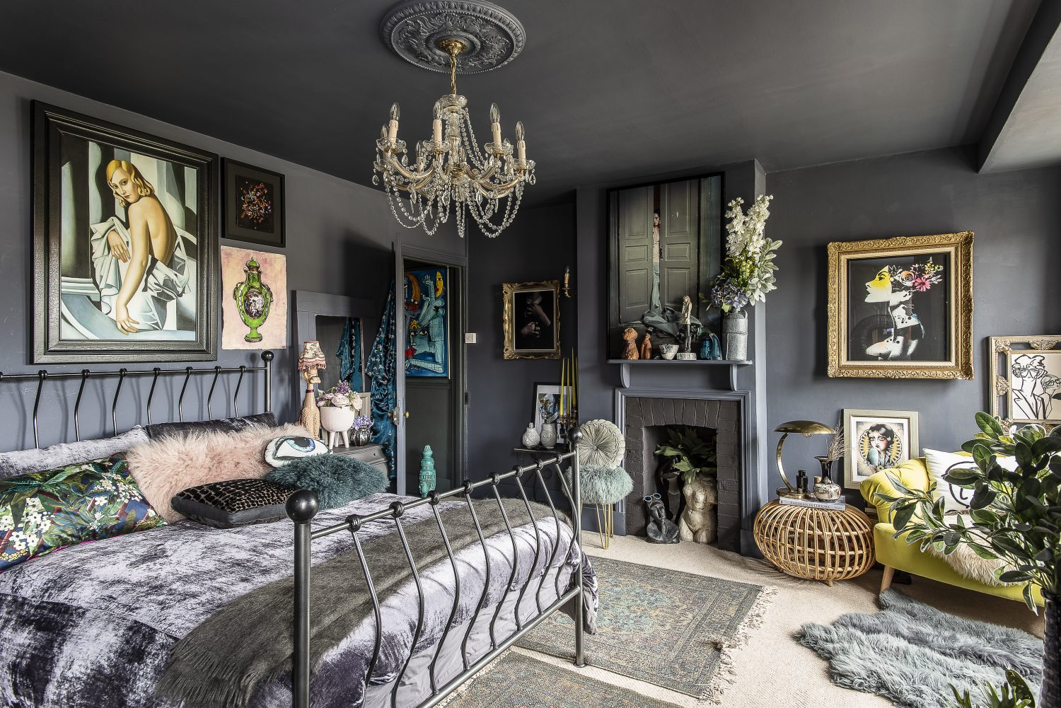 Jaz mixes real pot plants with faux ones. A very clever way to fill your house with greenery, without creating a plant-care overload. Textures throughout this bedroom, and the chandelier above the bed, add to its luxurious and inviting feel