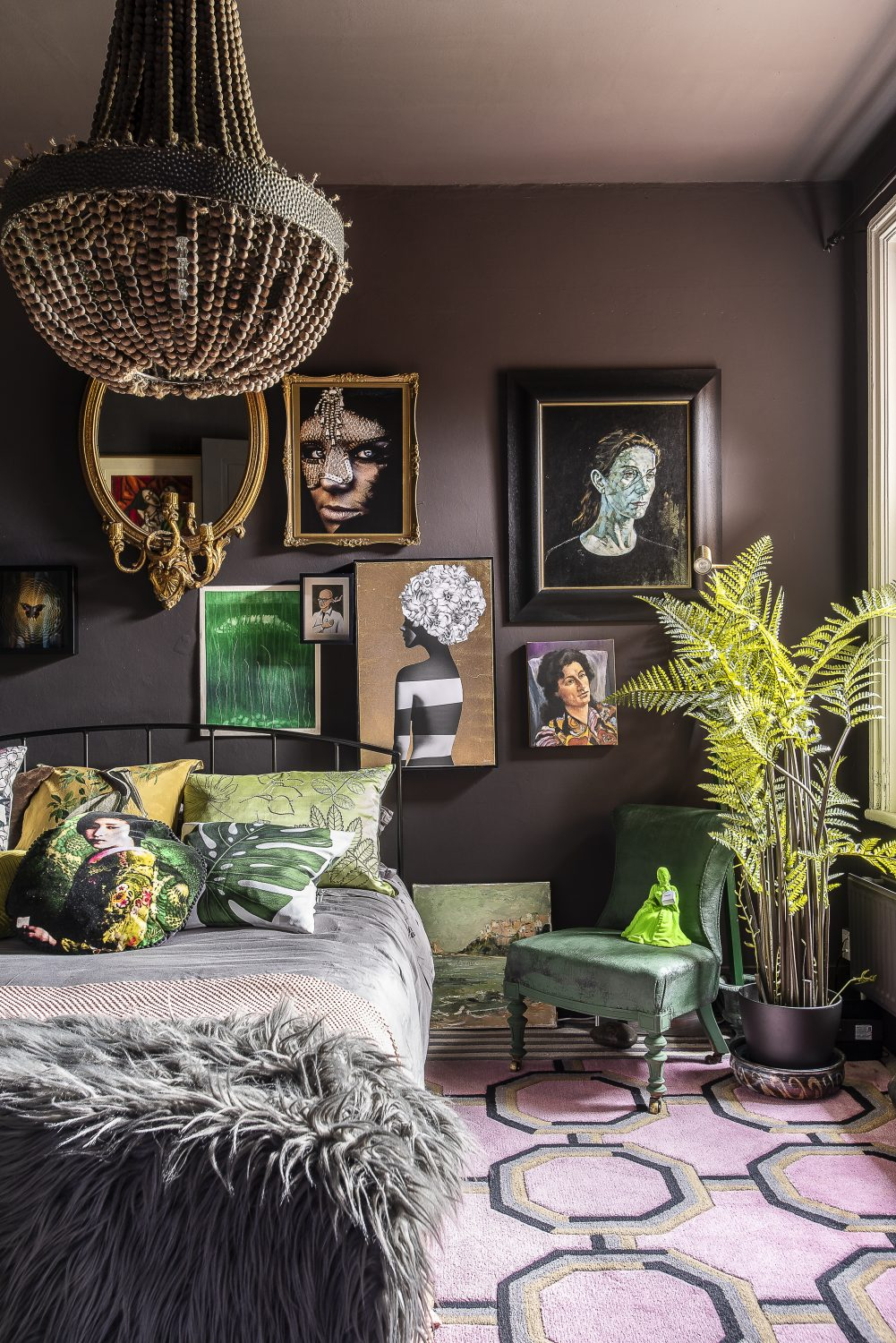 Although painted in deep, rich tones, the bedrooms are surprisingly airy, with light flooding in from large windows, reflected in touches of gilding and with greenery bringing a bit of the outdoors in