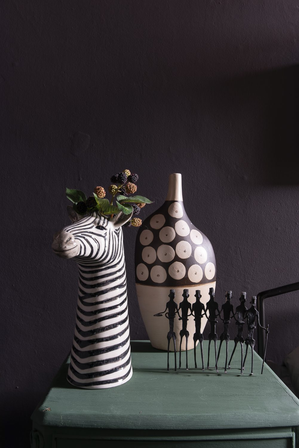 The zebra head pot, sourced from a shop called Hilary and Flo, is arranged with other pieces that Jaz has added to her collection over the years