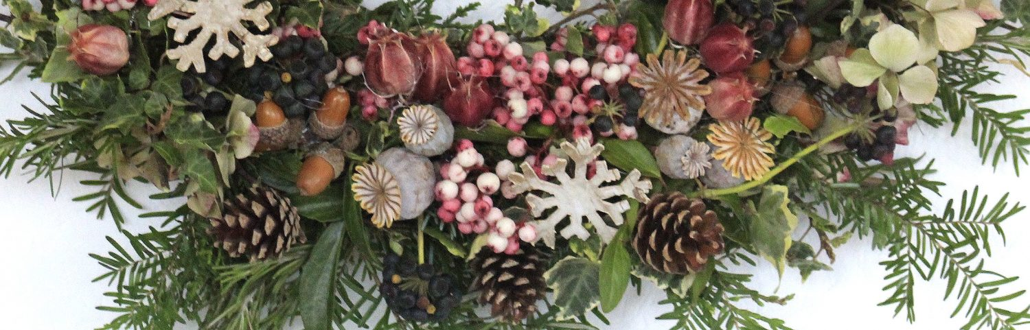 Section of a berry and cone wreath