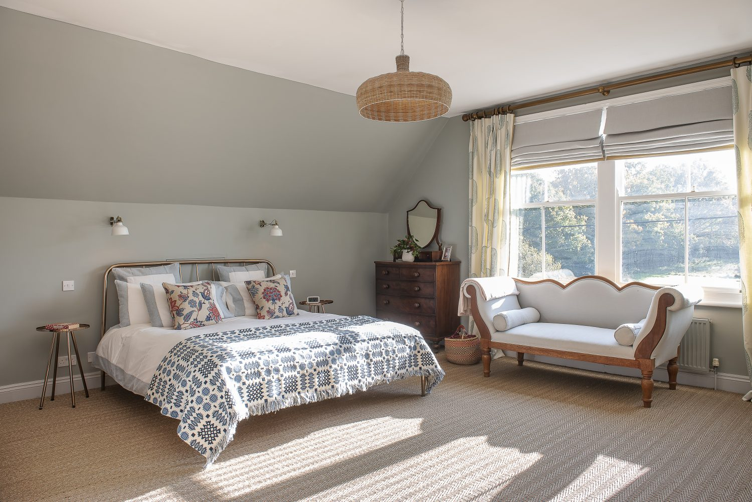 At the very top of the house, the light filled master bedroom looks out over the old post office and former village green