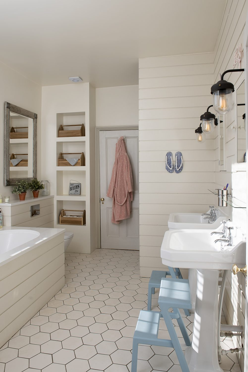 The Jack and Jill bathroom he shares with his sister was originally two rooms divided by a stud wall