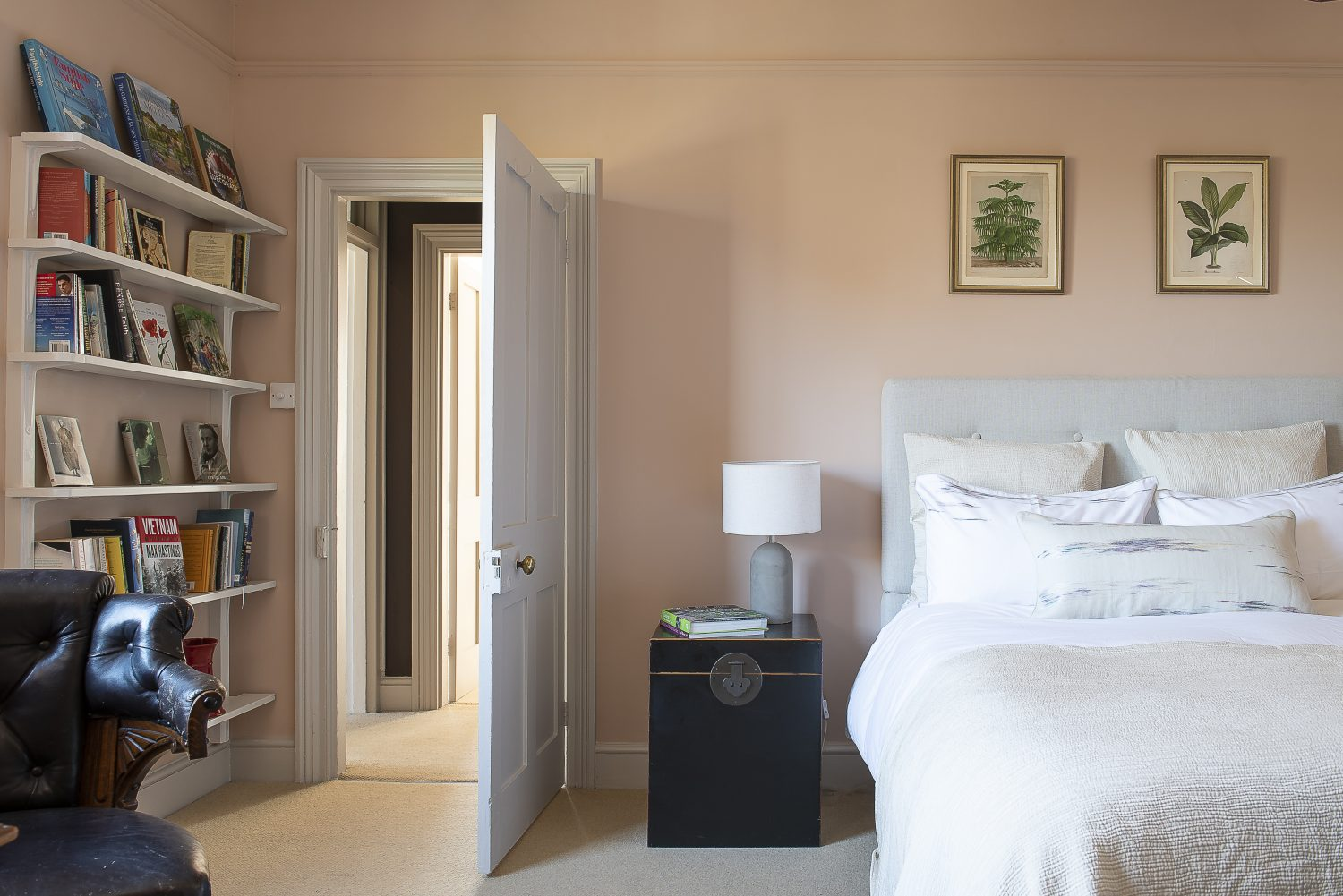 A pale pink spare bedroom is an inviting retreat