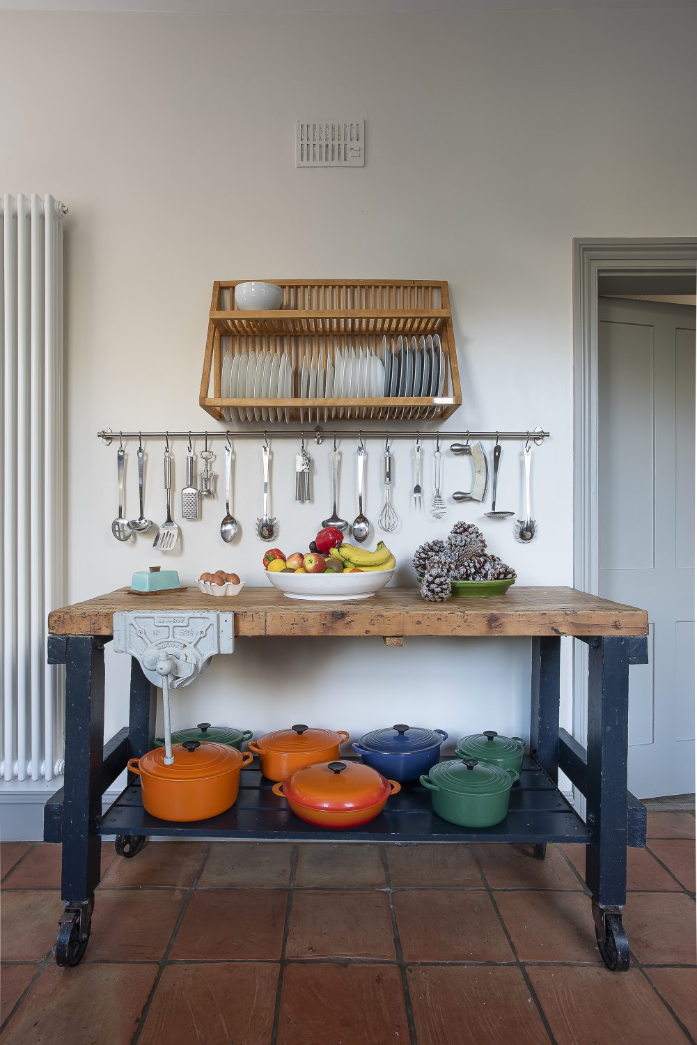An old butcher's block, which was found locally, serves as a work station, and doubles as a showcase for Toby's much loved collection of Le Creuset casseroles