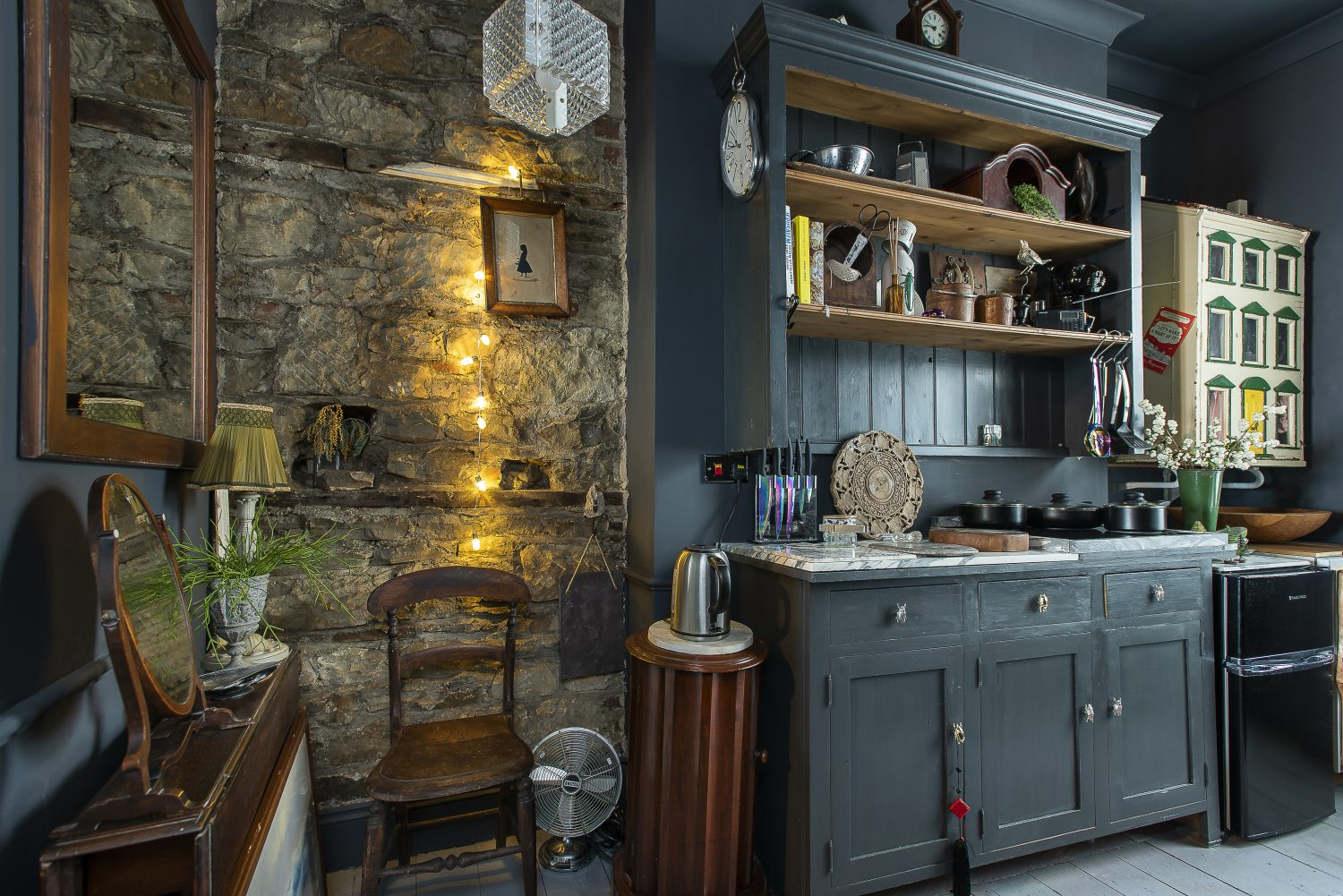 A special feature of the kitchen is the original stone wall, which was revealed when flaking plaster was chipped away