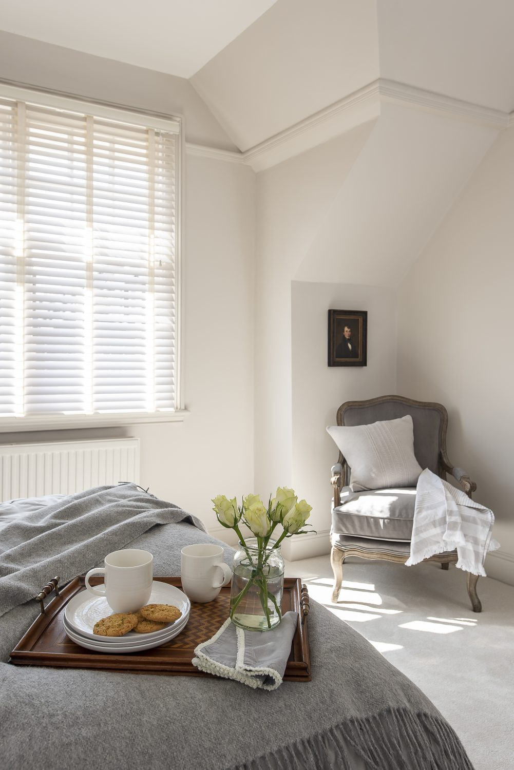 Slate grey bedside lamps from Mark Maynard complement the chair in this relaxing guest bedroom