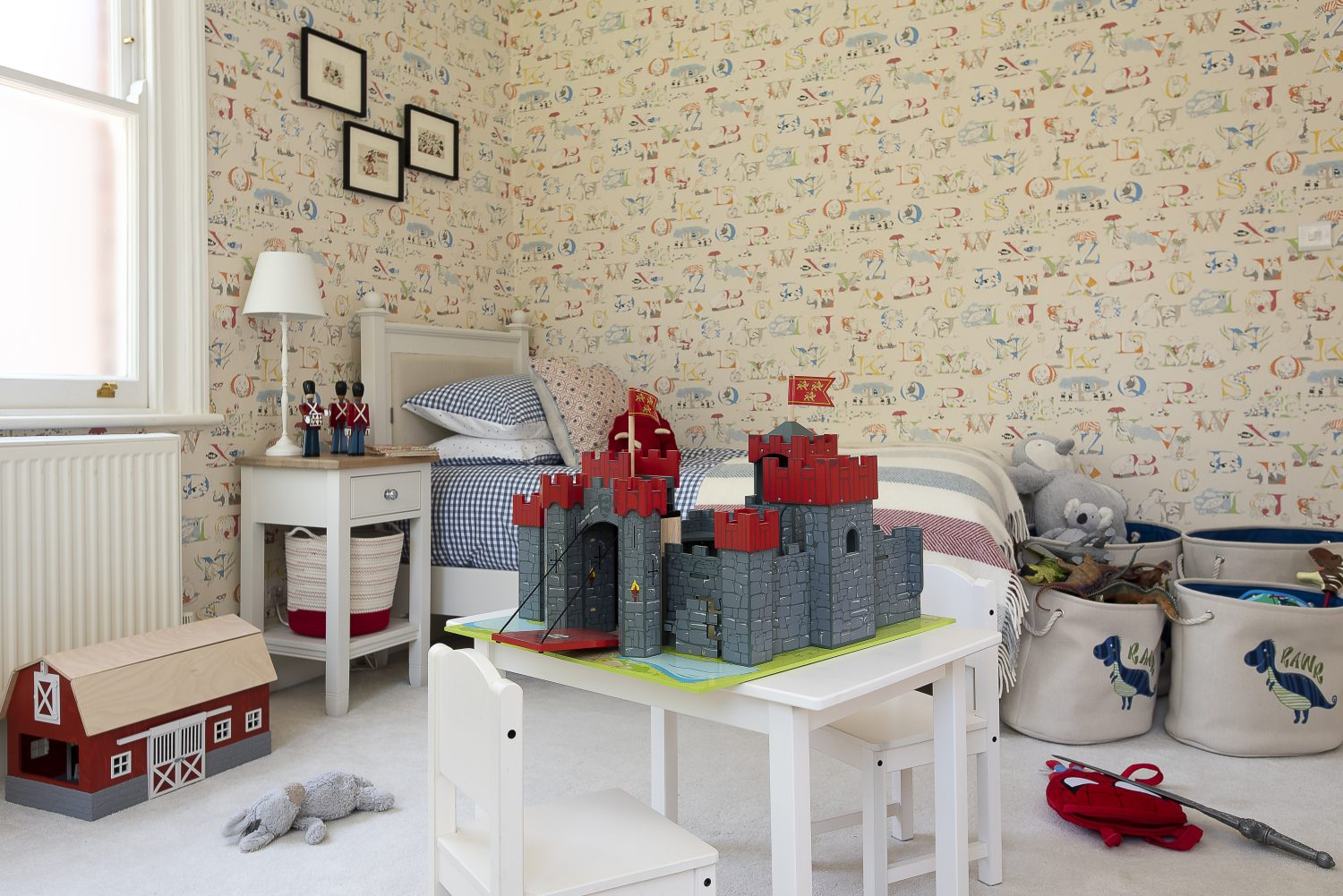 Jane Churchill's delightful alphabet wallpaper looks great in son Tom's fun bedroom