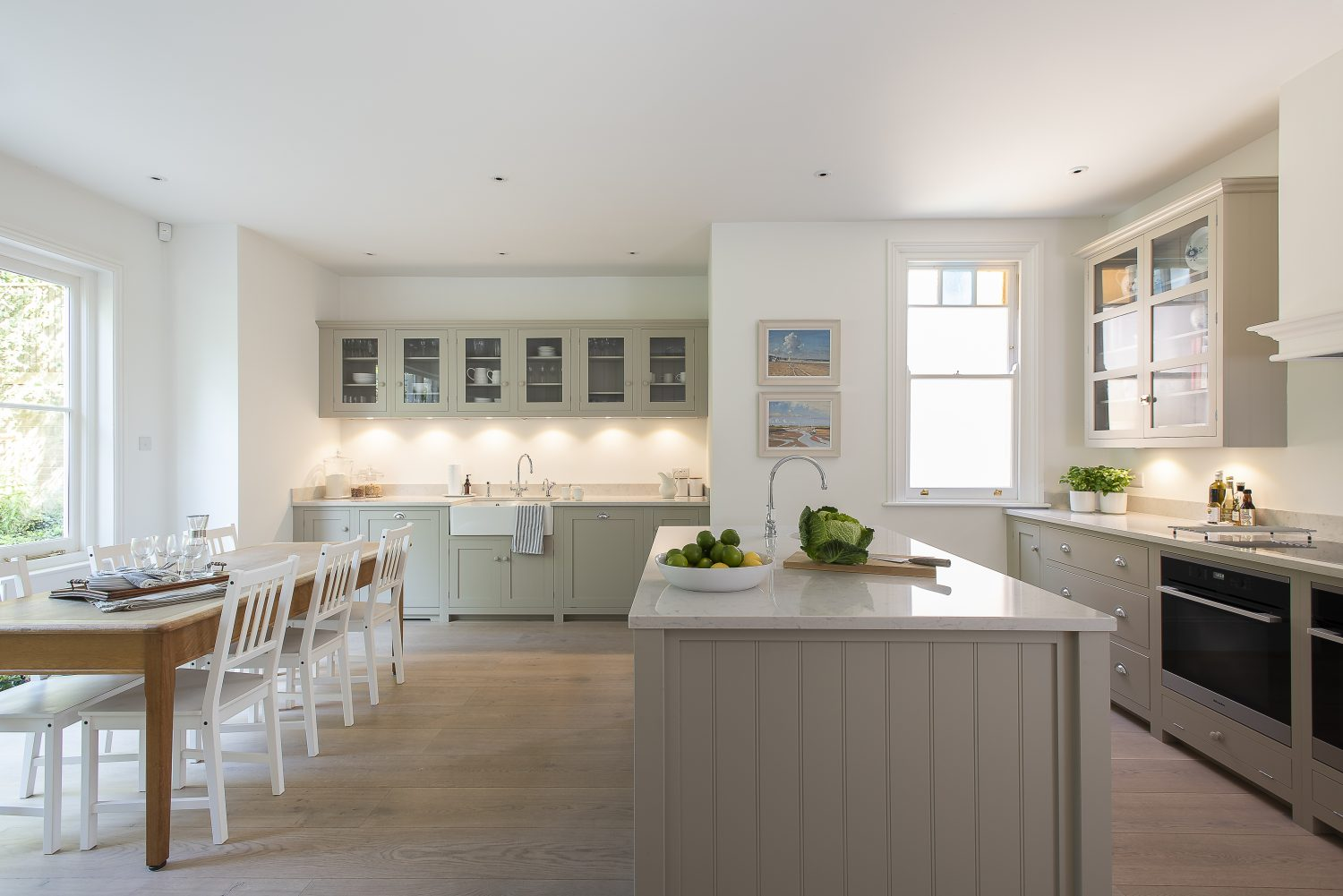 The lofty kitchen is home to a large central island and generous dining space